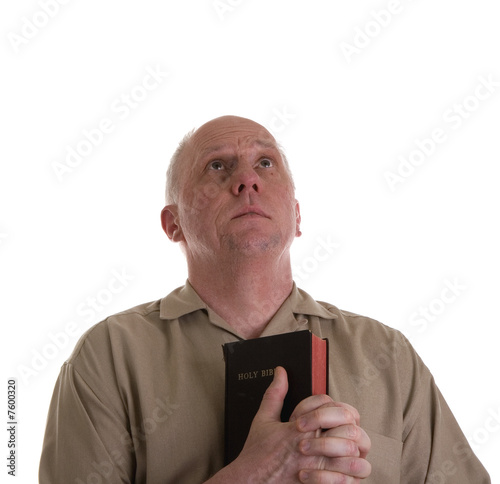 Man in Brown Shirt with Bible Praying
