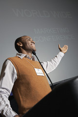 Business man giving presentation at conference meeting