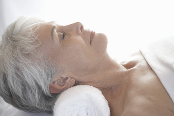 Woman relaxing in spa, head and shoulders, profile