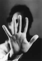 Man holding up hand, close-up of palm of hand, b&w