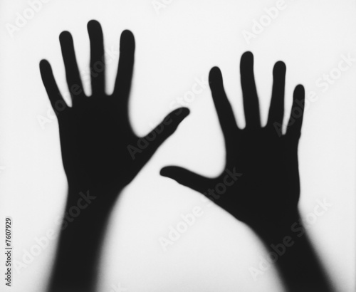 Black silhouettes of human hands against white background, b&w