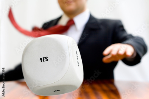Businessman throwing a dice