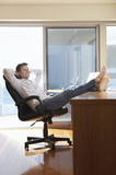 Man Relaxing with Feat Up