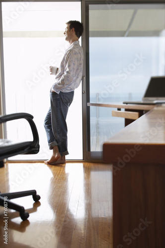 Man Relaxing by Sliding Glass Door