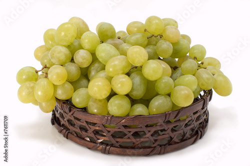 Green grapes in basket.