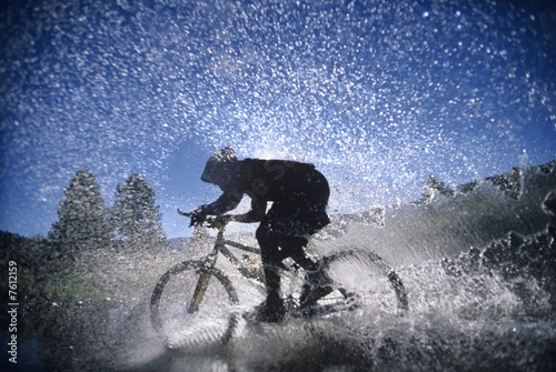 Bicyclist Splashing Through Water