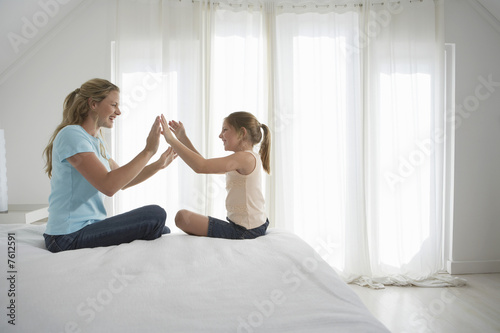 Mother and Daughter Playing Clapping Game