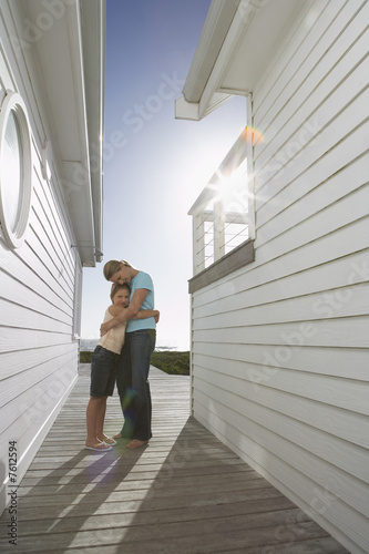 Woman Hugging Daughter on Deck
