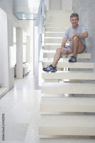 Man Resting on the Stairway