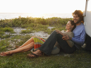 Couple Relaxing by Van