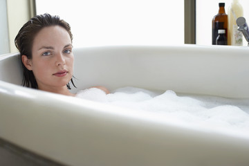 Young woman relaxing in bubble bath