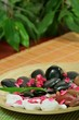 Spa composition of stones and red petals of flower