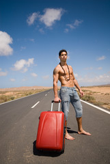 man on the road without shirt