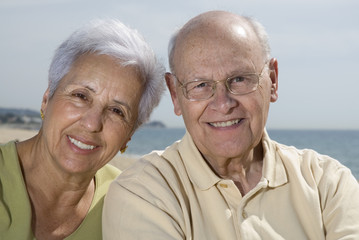 Senior smiling couple at the beach