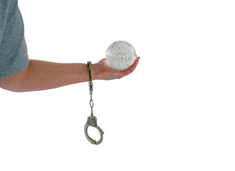 Crystal ball in hand with handcuffs