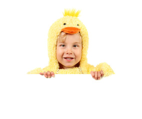 Boy in chicken costume holding sign