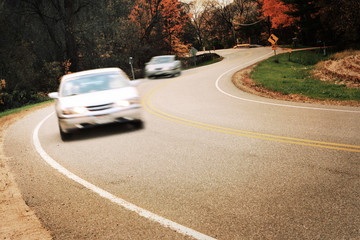 Around the curve, motion blur on cars