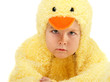 Unhappy boy dressed in a chicken suit