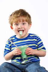 Messy young boy eating frozen dessert