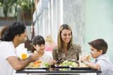 Fototapety Family enjoying lunch at cafe