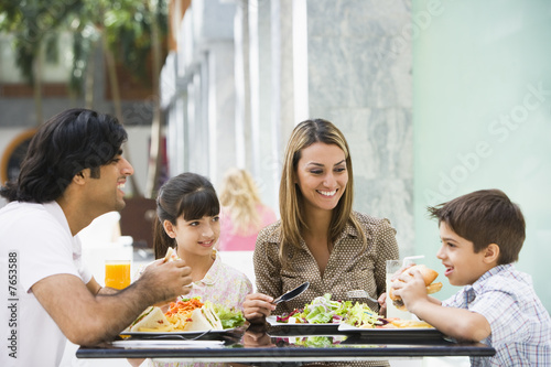 Family enjoying lunch at cafe