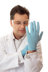 Doctor or scientist putting on nitrile safety gloves
