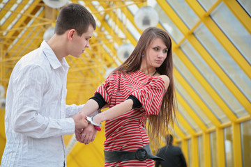Young couple with handcuffs