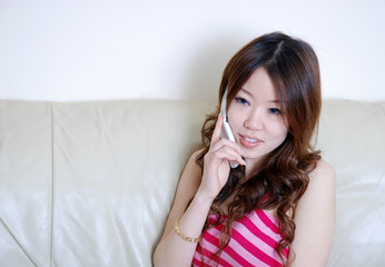 Happy Chinese girl on phone