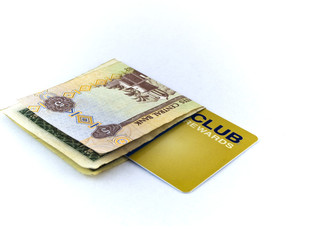 Five Dirham Note and Gold Membership Club Card on White Backgrou