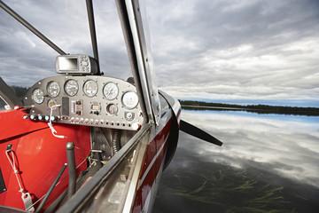 USA, Alaska, cockpit of sea plane on lake, close up