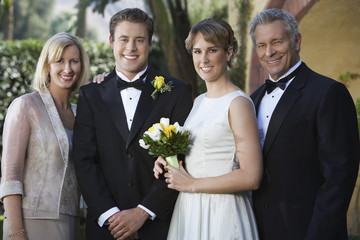 Bride, groom, and parents, portrait