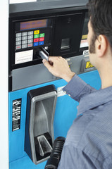 Man paying with credit card at fuel pump