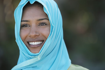 Portrait of muslim woman in blue headscarf, smiling
