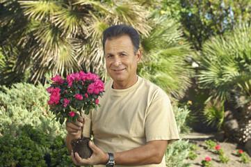 Portrait of man with flowers in garden