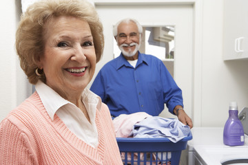 Senior couple with laundry