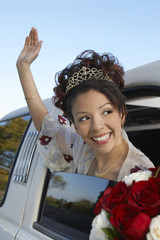 Girl 13-15 waving from car window at Quinceanera