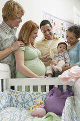 Two couples and baby 1-6 months by cradle