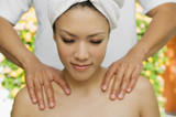 Young woman having shoulder massage at health spa