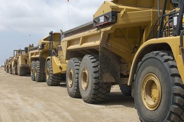 Row of trucks at landfill site