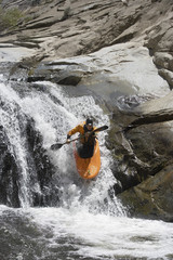 Man kayaking in mountain river