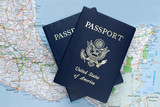 Two American passports over map of Mexico, Caribbean