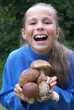 Cheerful peteen girl with mushrooms