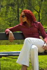 Beautiful young women on bench in park