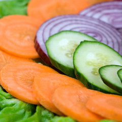 Cucumbers, onions and carrots close-up