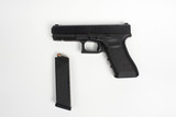 handgun with clip on white background