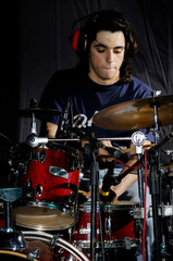 Portrait of young musician playing the drums