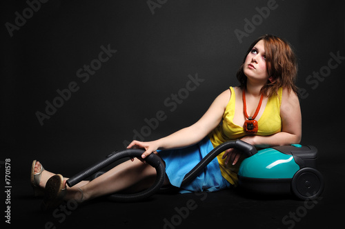poster of Young girl resting and playing with vacuum cleaner.