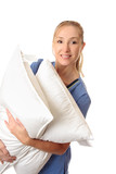 Healthcare worker carrying patient pillows
