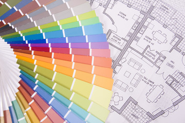 colorful palette over a blueprint