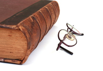 Old book and an eyeglasses